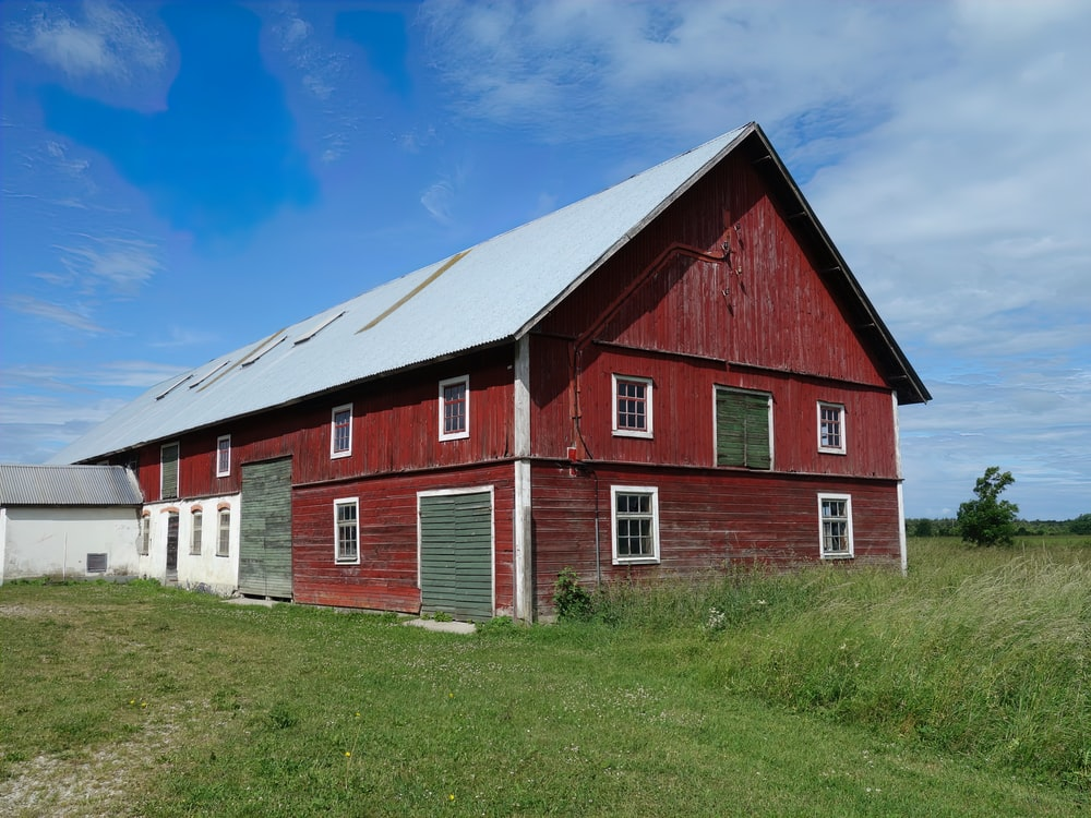 red and white barn under blue sky during daytime