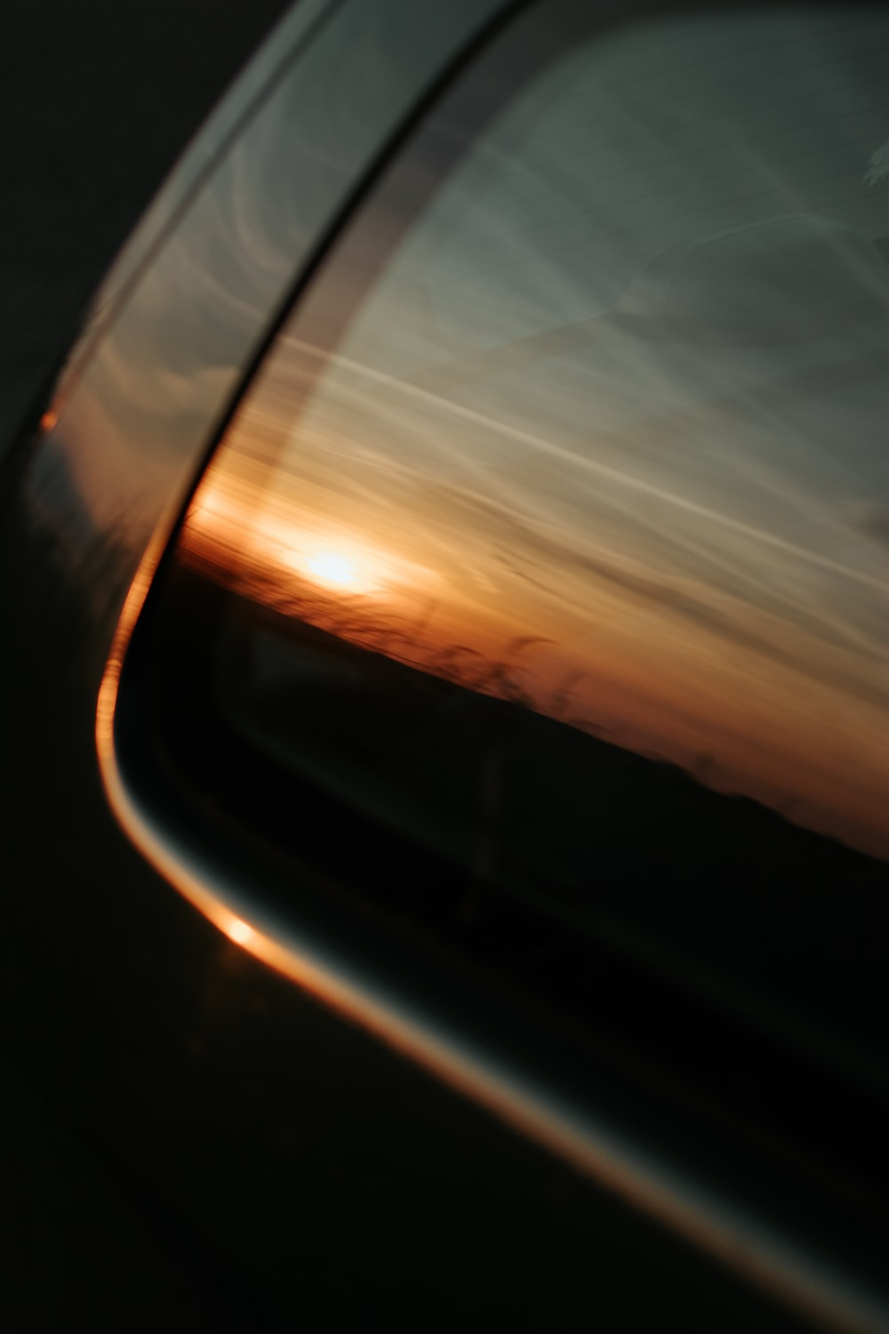 car side mirror during sunset