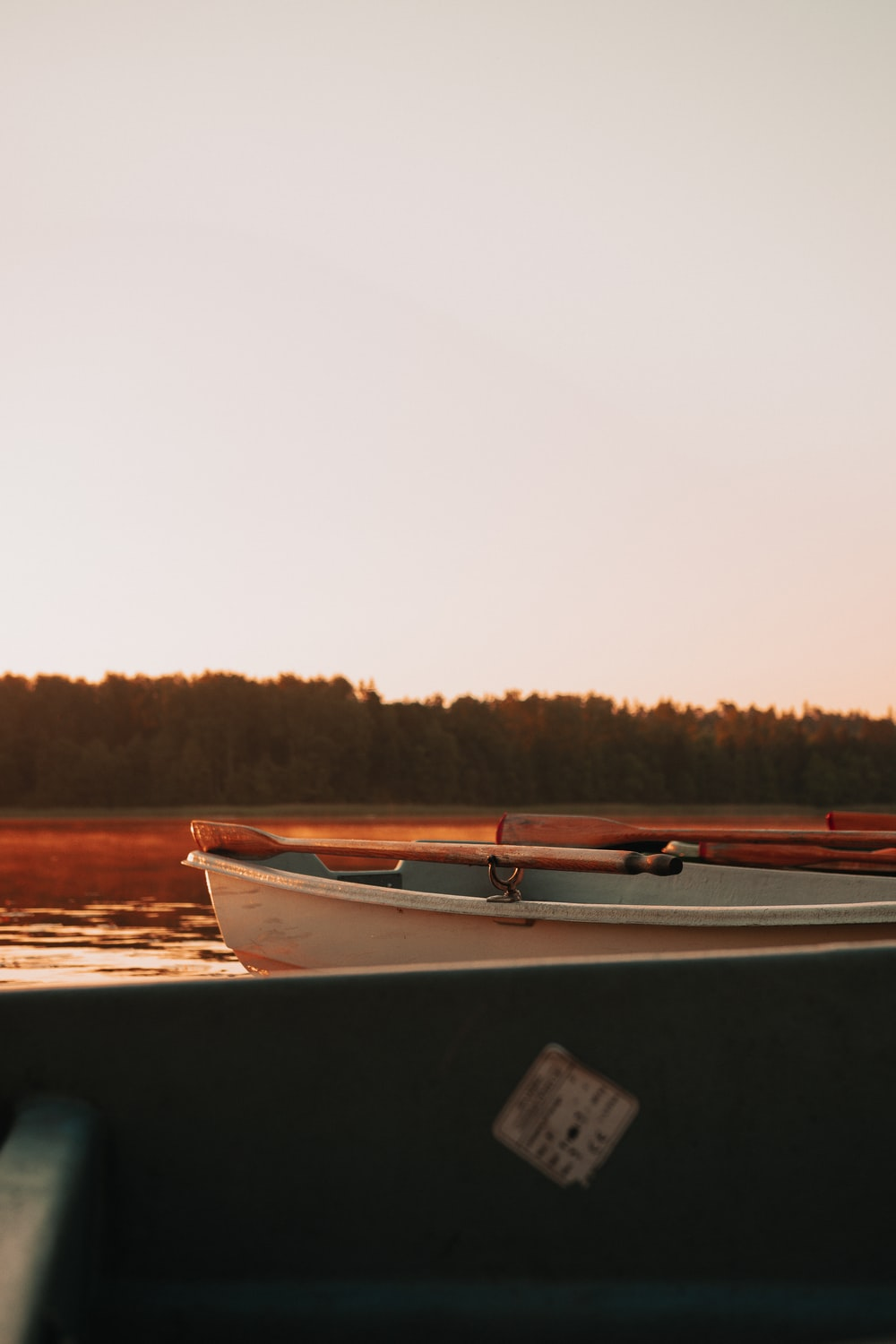 white and brown boat on water during daytime
