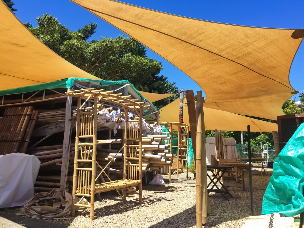 brown wooden playground under blue and white sunny sky during daytime
