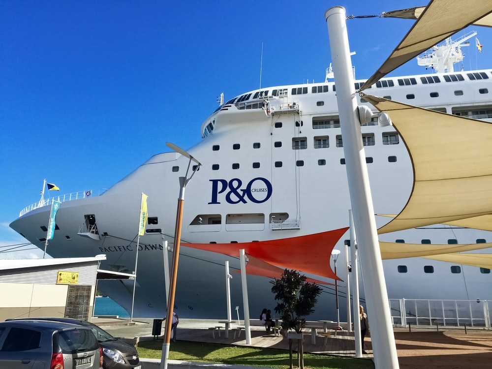 white and orange ship on dock during daytime