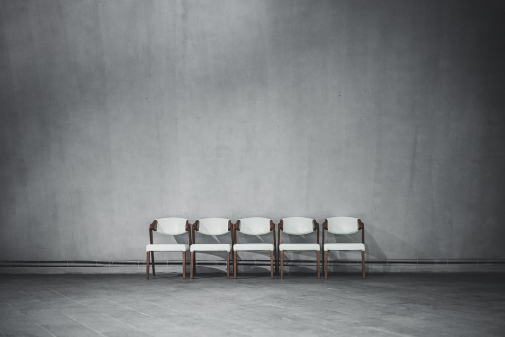 brown wooden chairs on gray floor