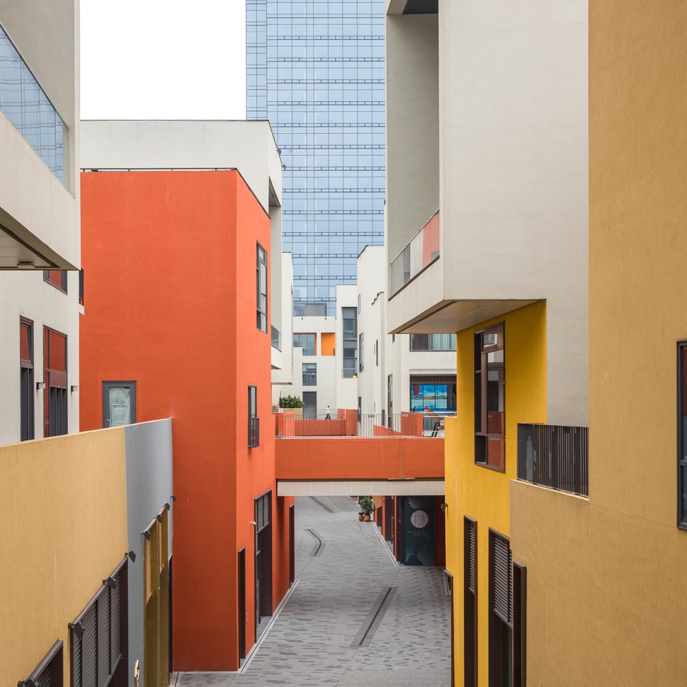 orange and white concrete building during daytime