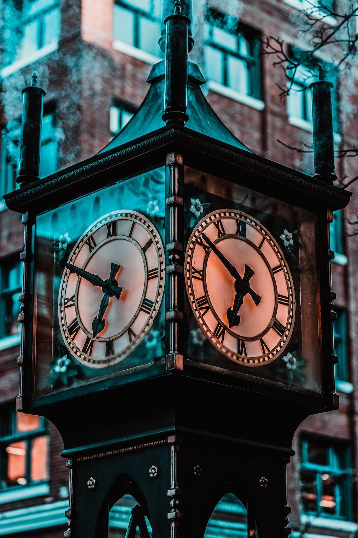 black wooden analog clock at 10 30