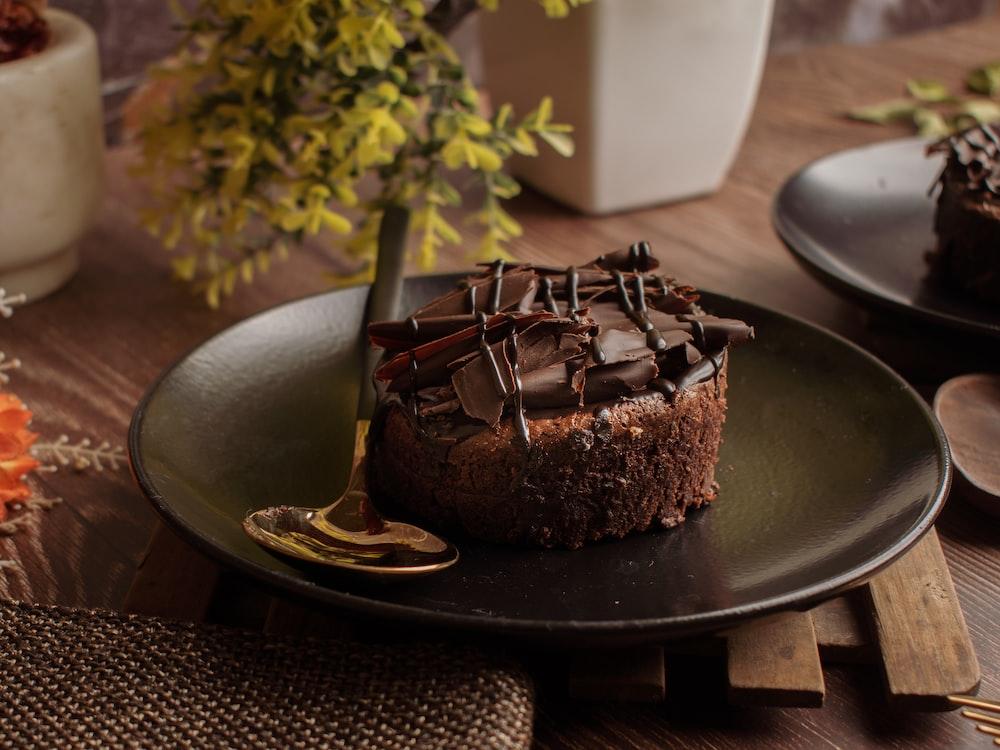 chocolate cake on black round plate