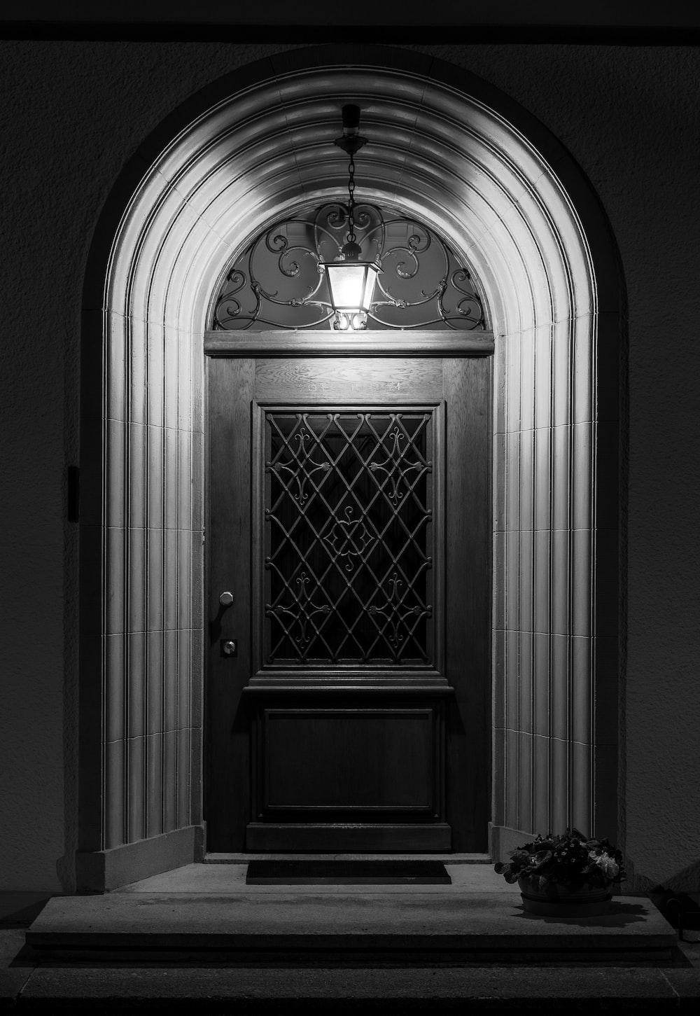 black wooden door in gray scale