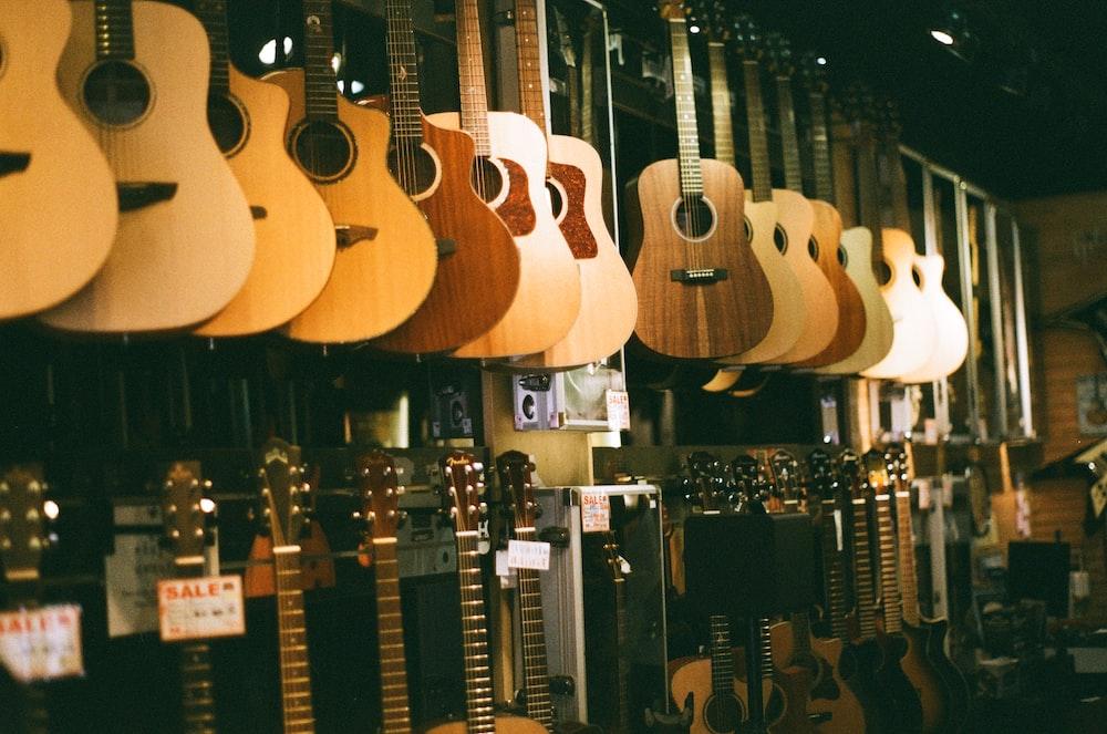 brown acoustic guitars on display