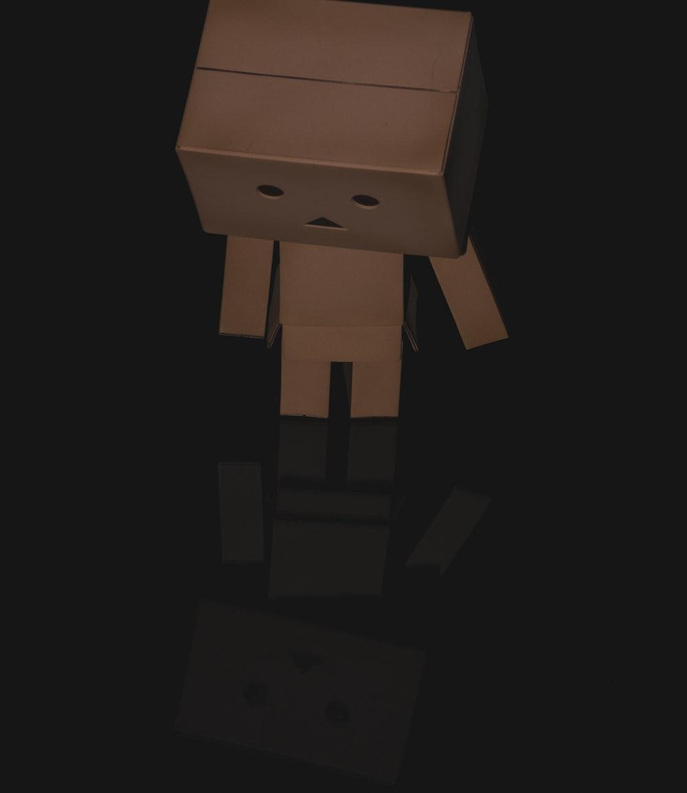 brown cardboard robot on white background