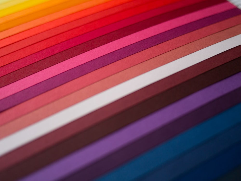 red yellow blue and purple striped textile