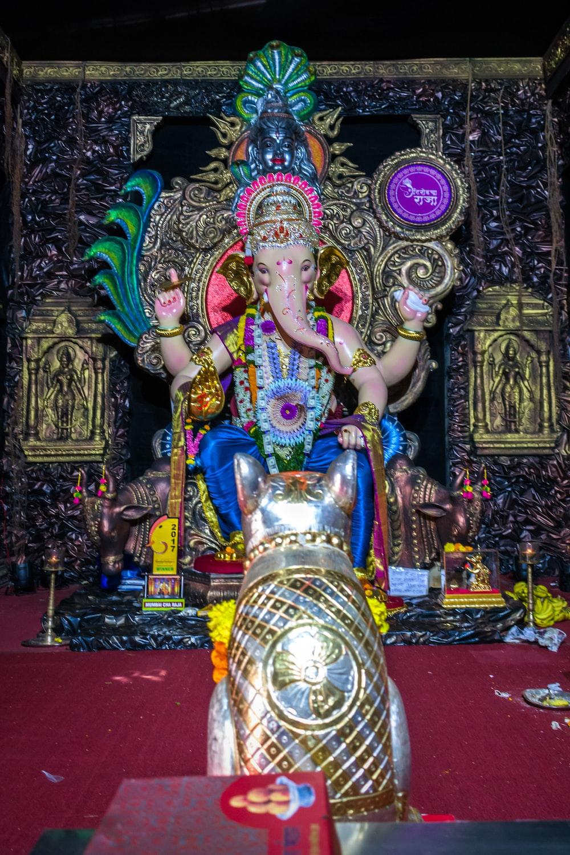 hindu deity statue on red textile