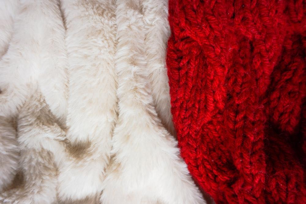 white fur textile on red textile