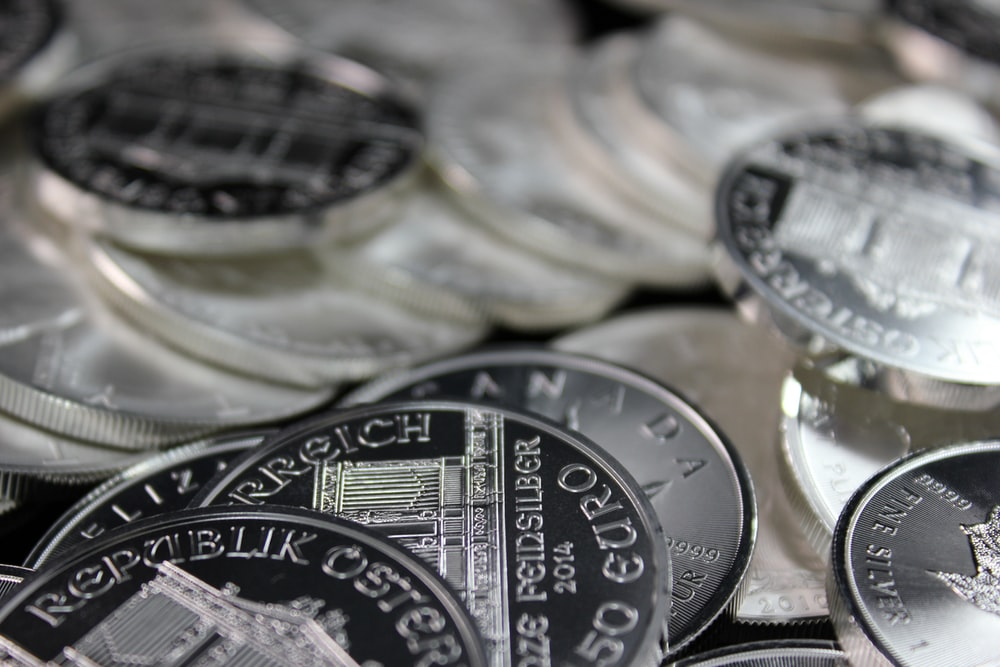 silver and black round coins