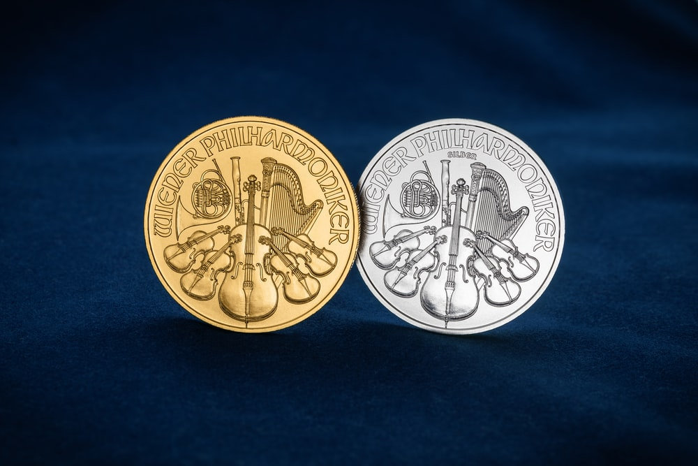 2 round gold coins on blue textile