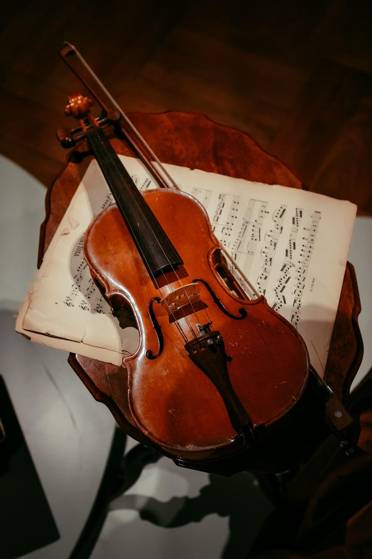 brown violin on white paper