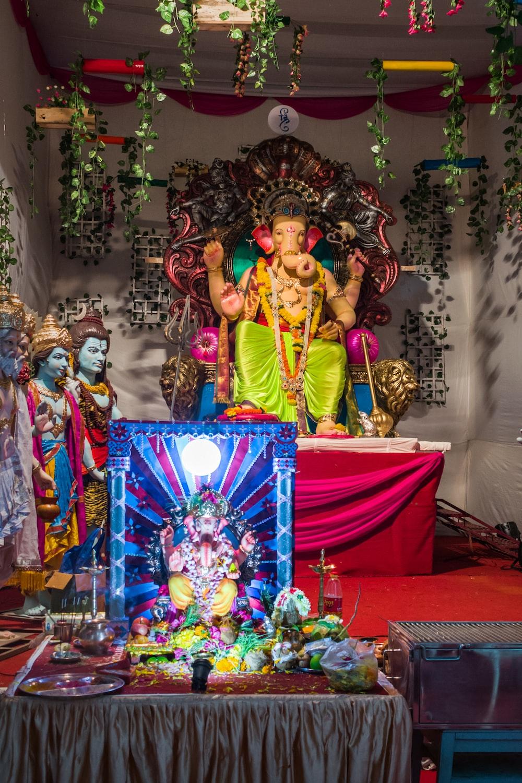 hindu deity figurine on red textile
