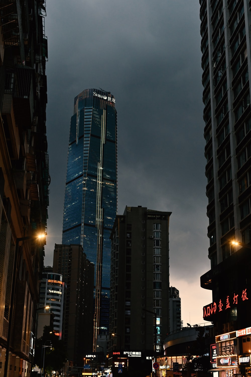low angle photography of high rise buildings during night time