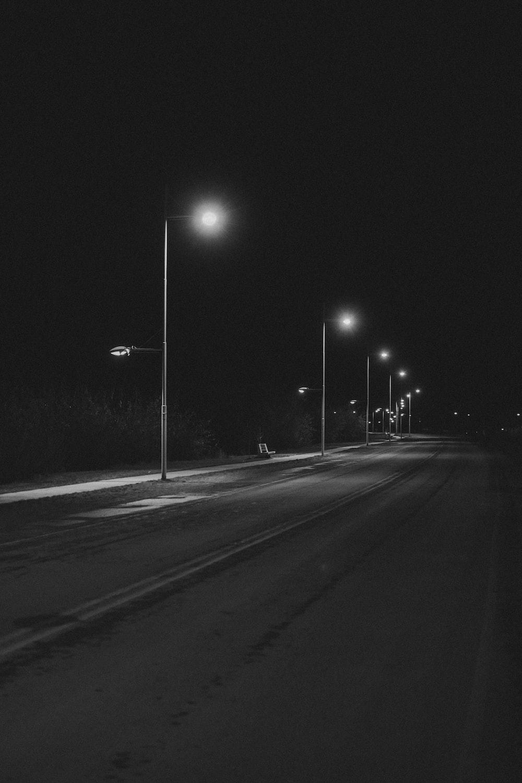 grayscale photo of street lights