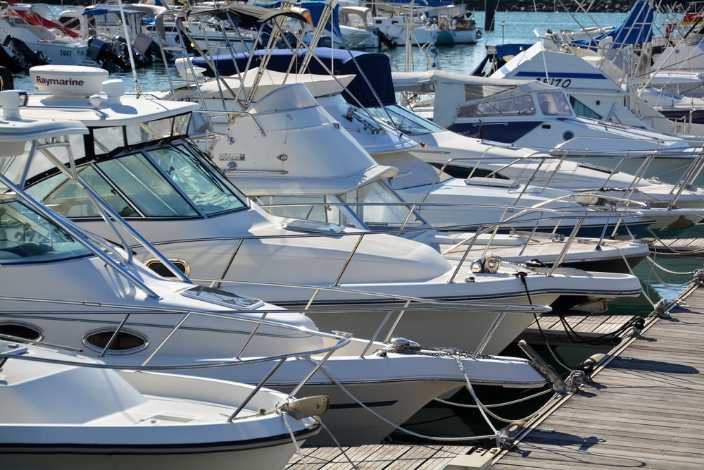 white and brown boats on dock during daytime
