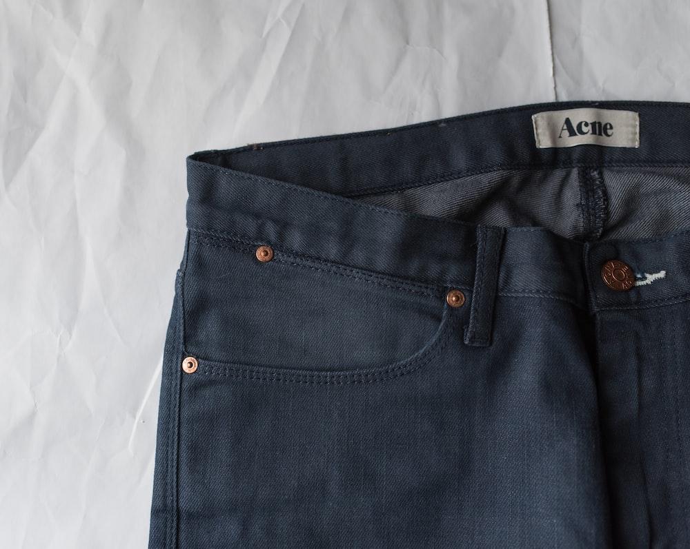 blue denim bottoms on white textile