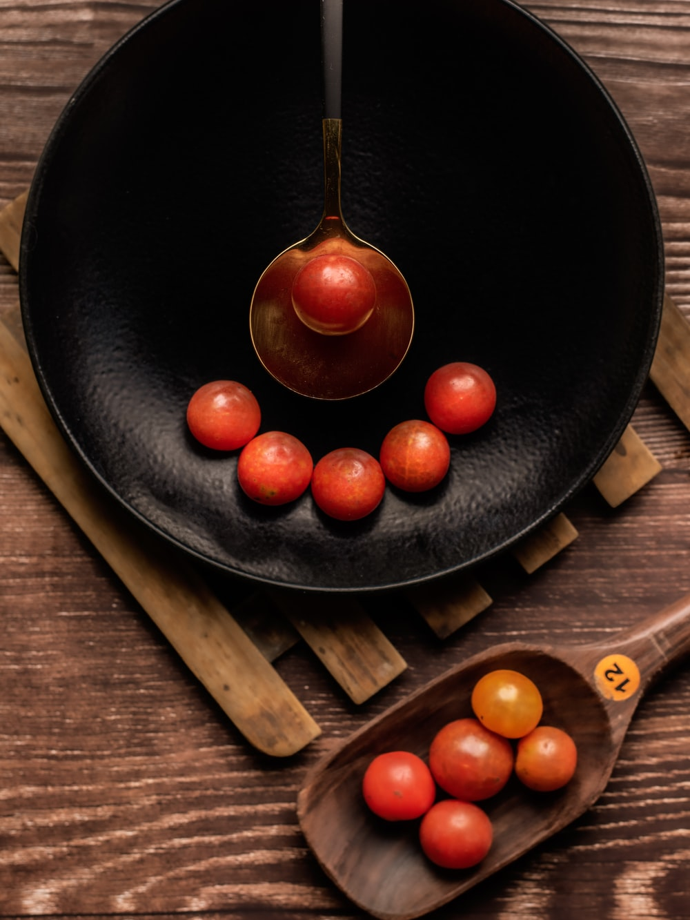 red tomato on black ceramic plate