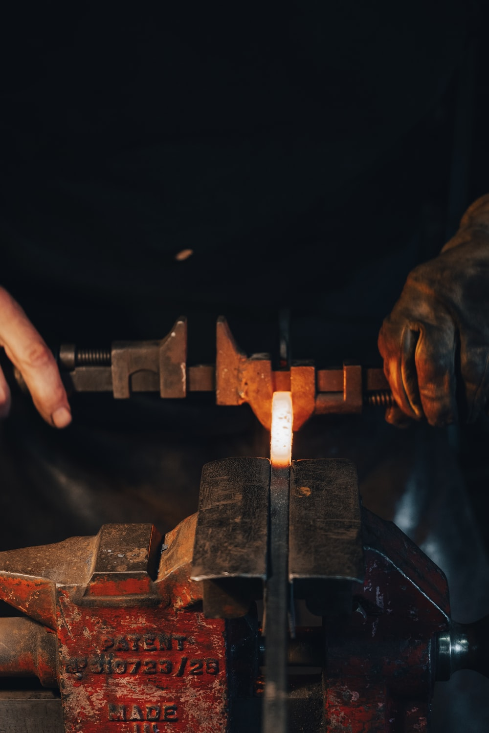 person holding brown metal tool