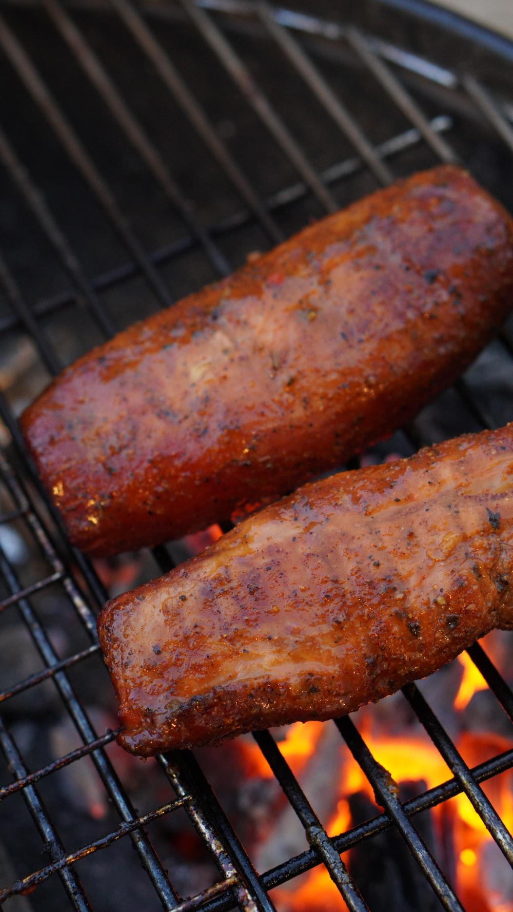 grilled sausage on black metal grill