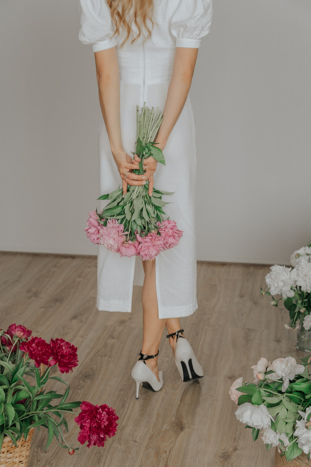 woman in white sleeveless dress and black leather shoes