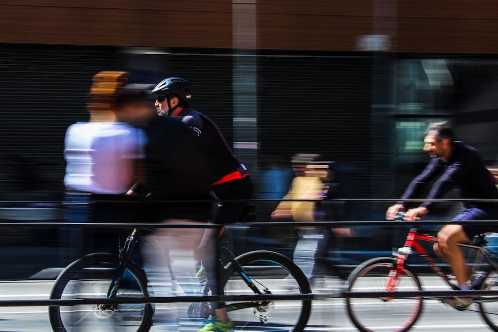 man in black jacket riding bicycle