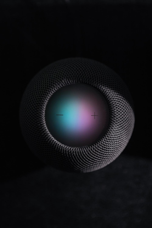 black and gray round portable speaker