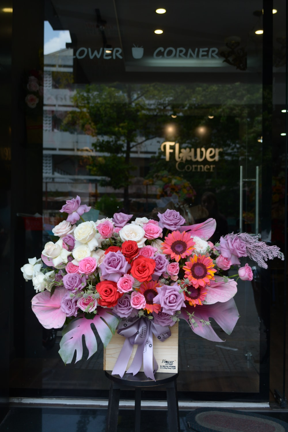 pink and white flowers on glass window