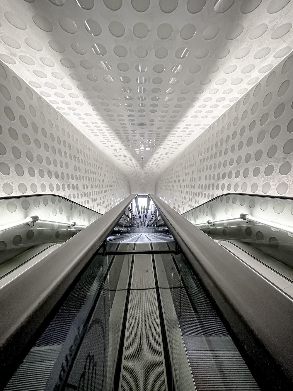 white and gray concrete tunnel