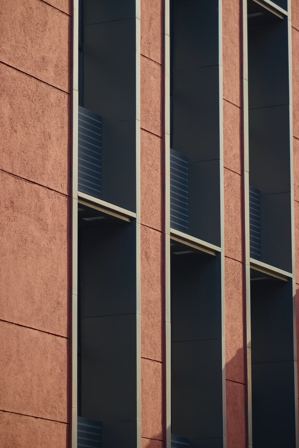 brown concrete building with glass windows