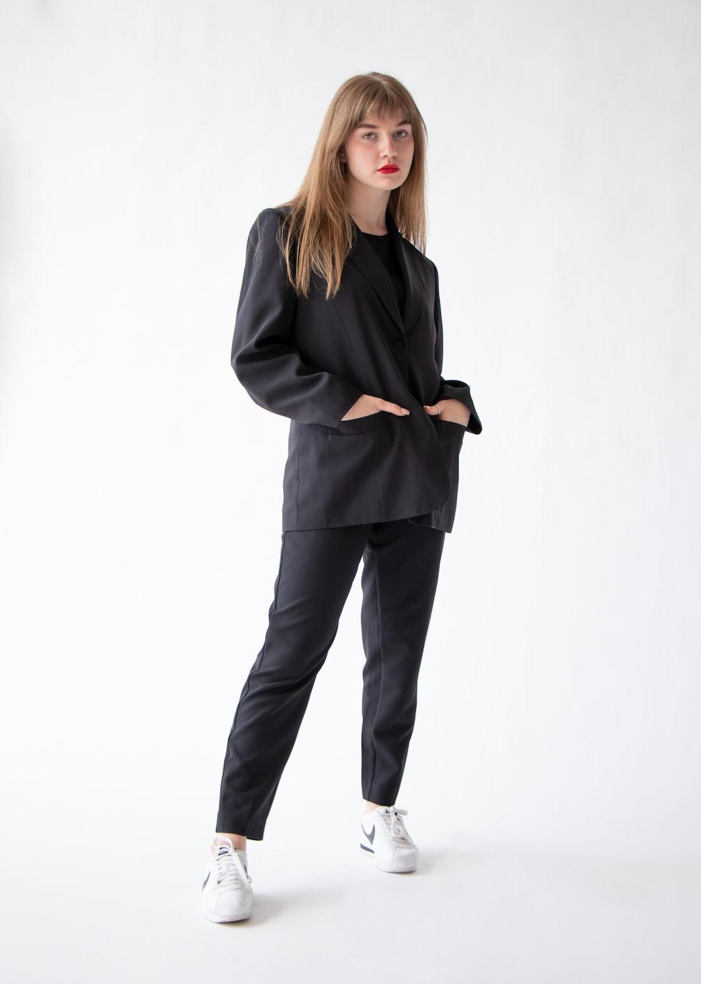 woman in black blazer and blue denim jeans
