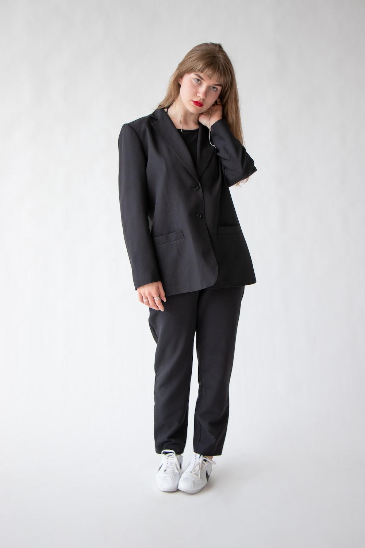 woman in black blazer and black pants