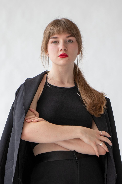 woman in black tank top and black blazer
