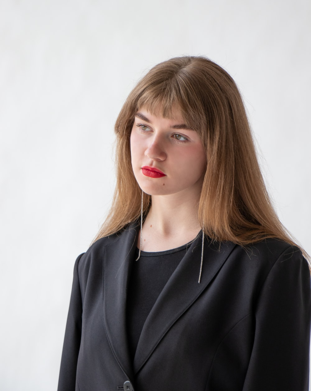 woman in black blazer with blonde hair