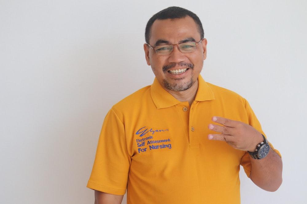 man in yellow polo shirt smiling