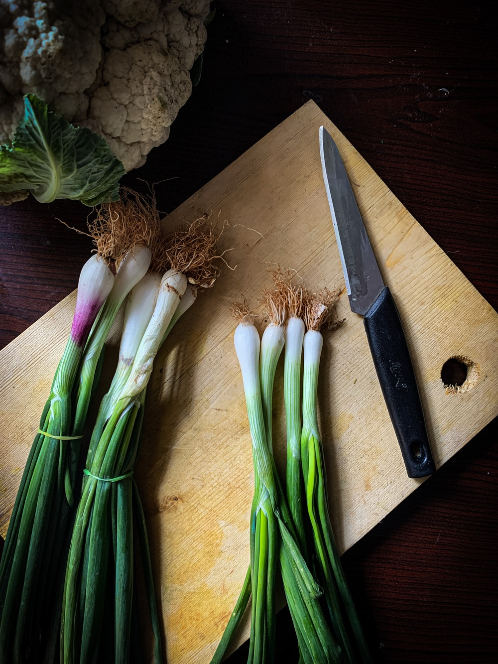 green and white vegetables on brown wooden chopping board
