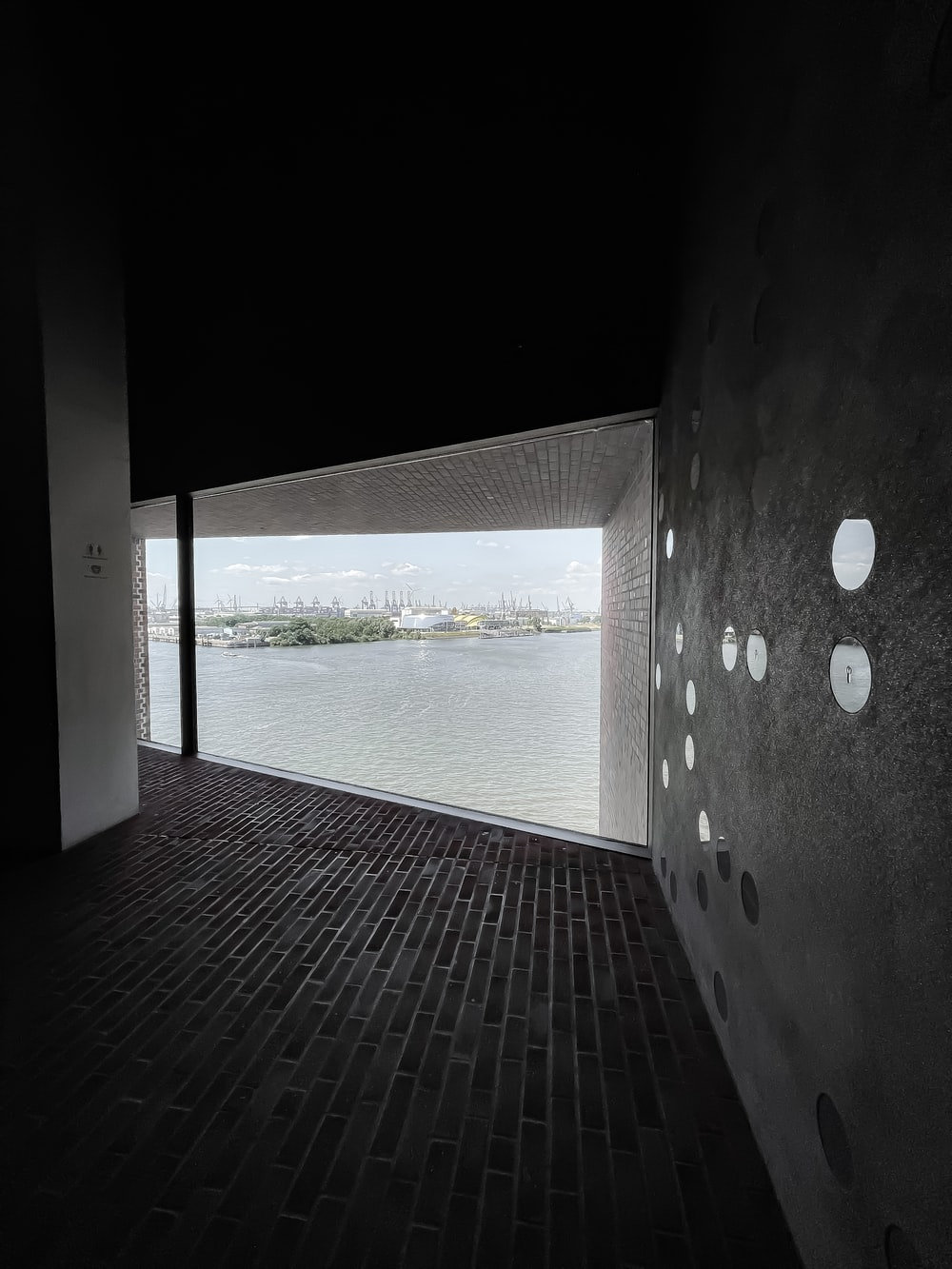 black and white concrete building near body of water during daytime