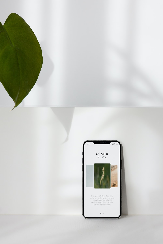 black iphone 5 on white printer paper