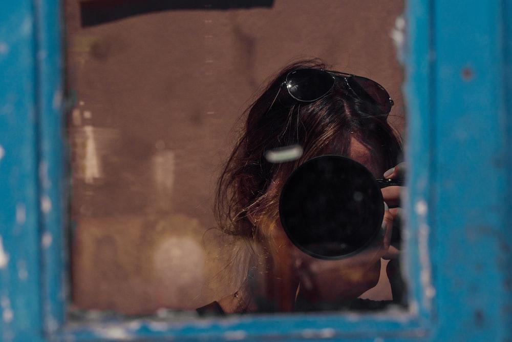 woman wearing black sunglasses during daytime