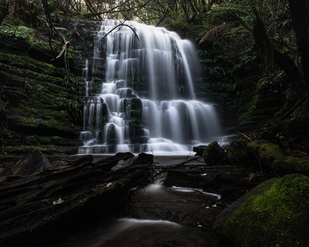 water falls on brown rocky ground