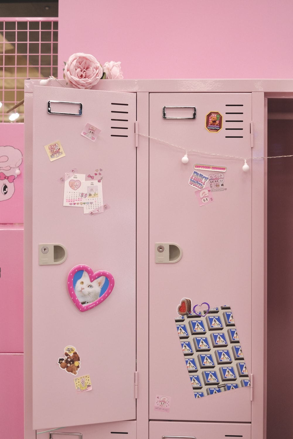 pink and white cabinet with stickers