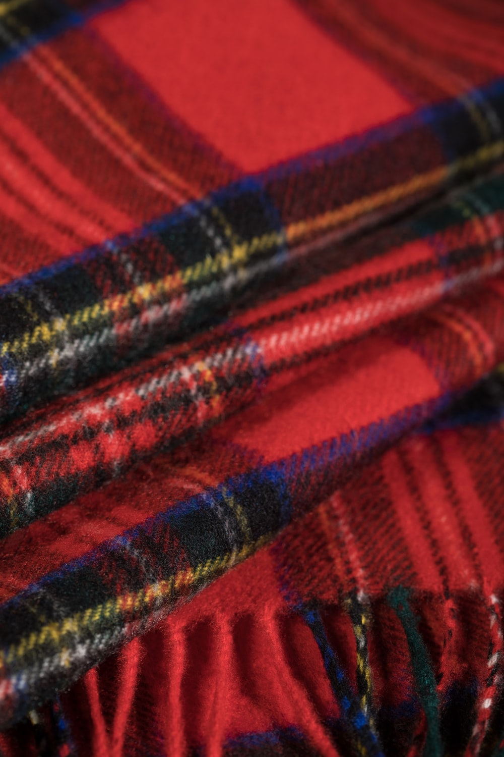 red blue and black plaid textile
