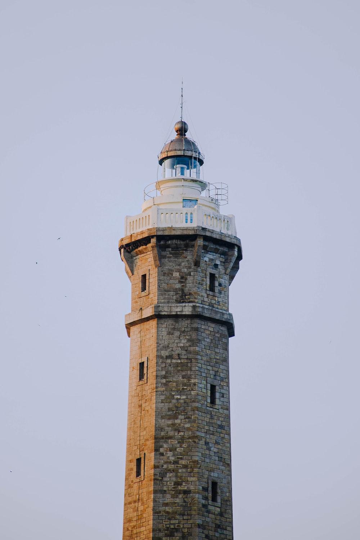 brown brick tower under white sky