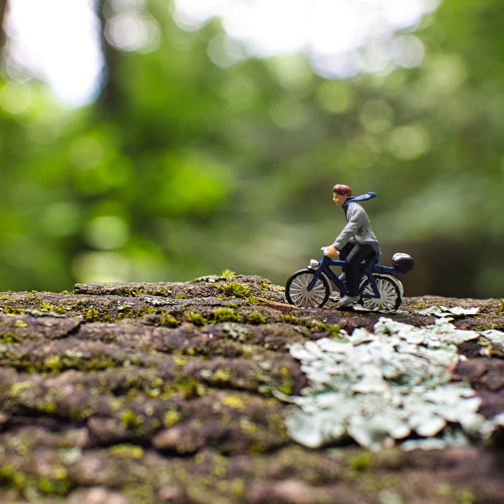 man riding motorcycle on gray rock during daytime