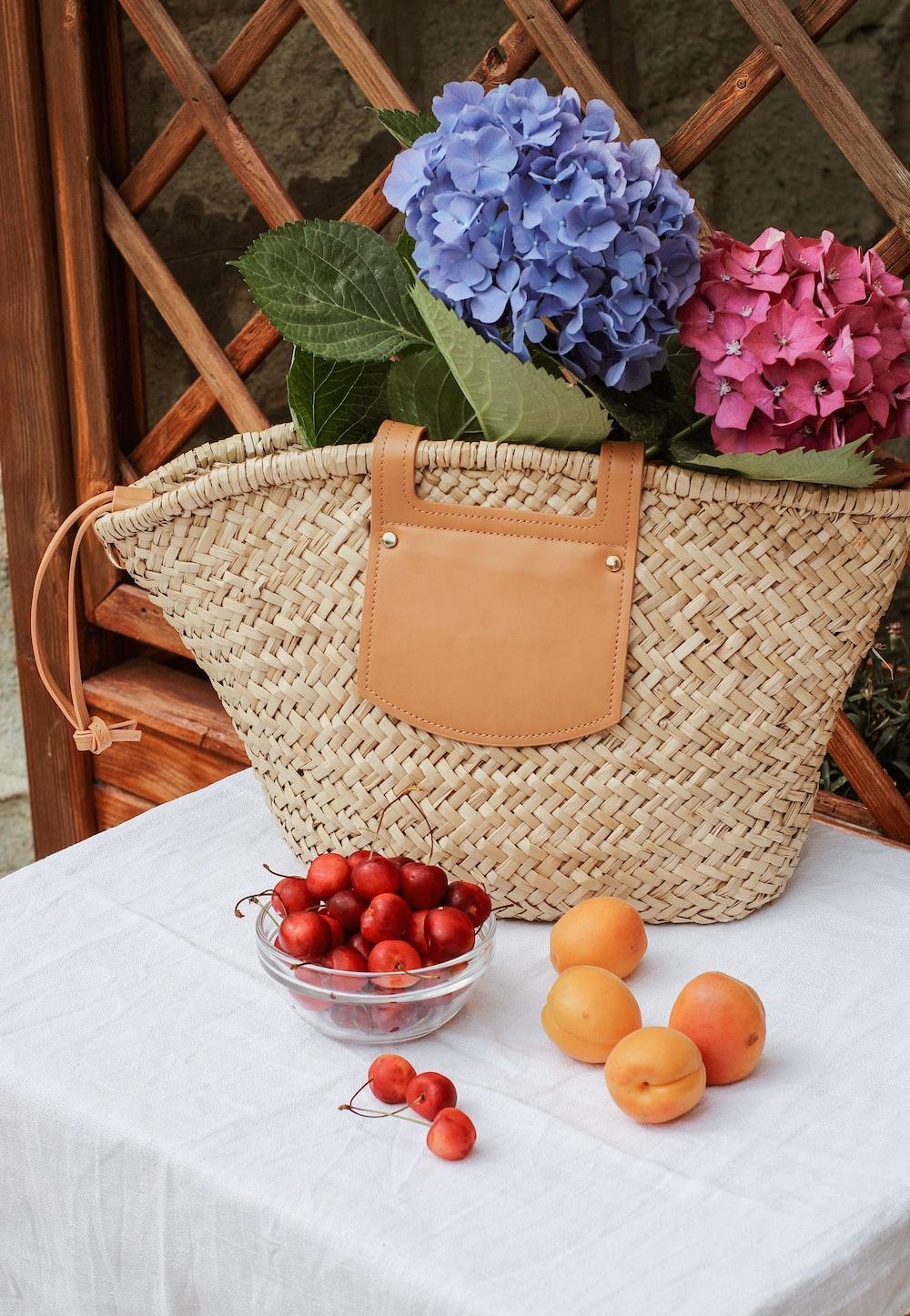 orange fruits on brown woven basket