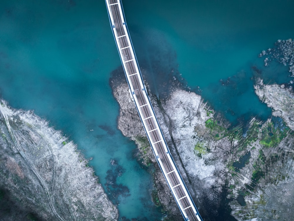 aerial view of bridge on body of water during daytime