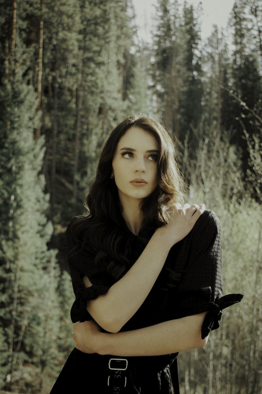 woman in black sleeveless dress
