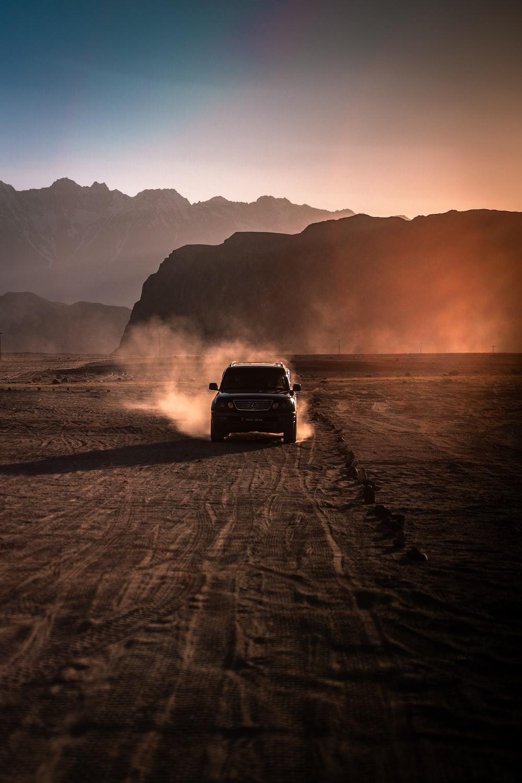 black chevrolet car on beach during sunset